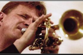 Geoff playing Bix's horn,Davenport,Iowa,August 2006. Photo courtesy of Quad City Times newspaper